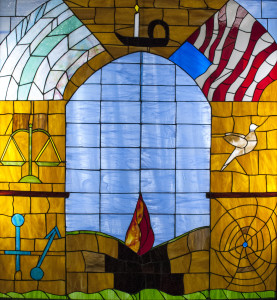 UUFC member Nikki Rohrs created this stained glass, which illustrates the Seven Principles of Unitarian Universalism.